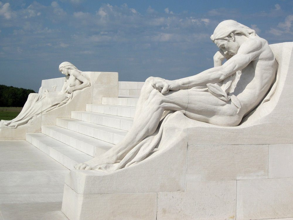 The male and female mourners reclining aside the steps of the monument.