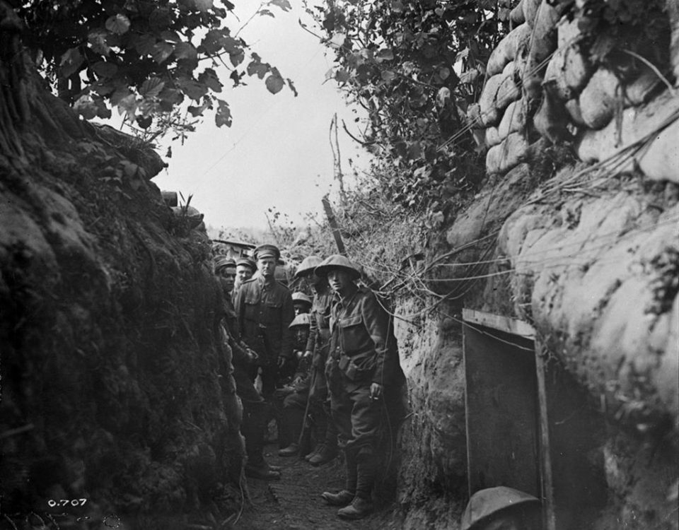 Canadians in a communication trench (LAC M#3395567).