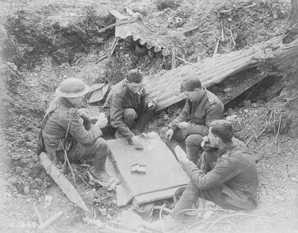 Playing cards in a damaged trench, April 1917 (LAC M#3194322).