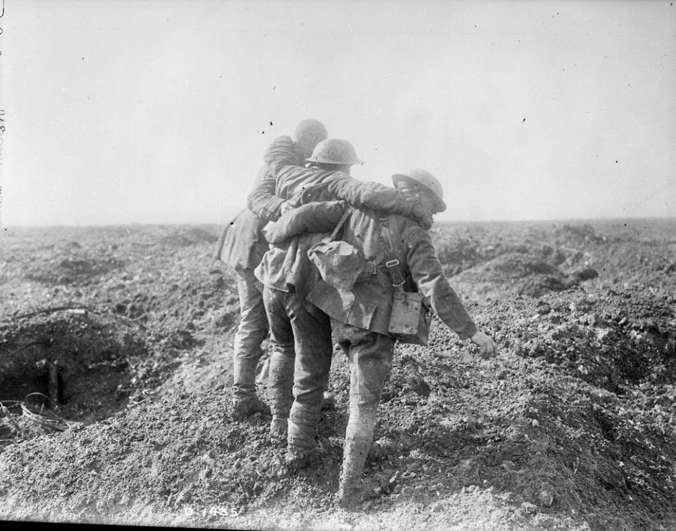 Soldiers bringing in a wounded comrade at Vimy (LAC M#3397007).