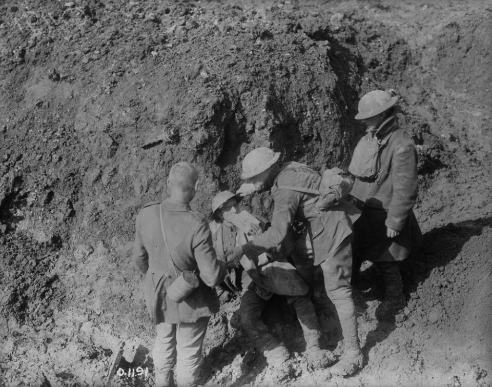 Providing first aid to an injured at Vimy (LAC M#3521860).
