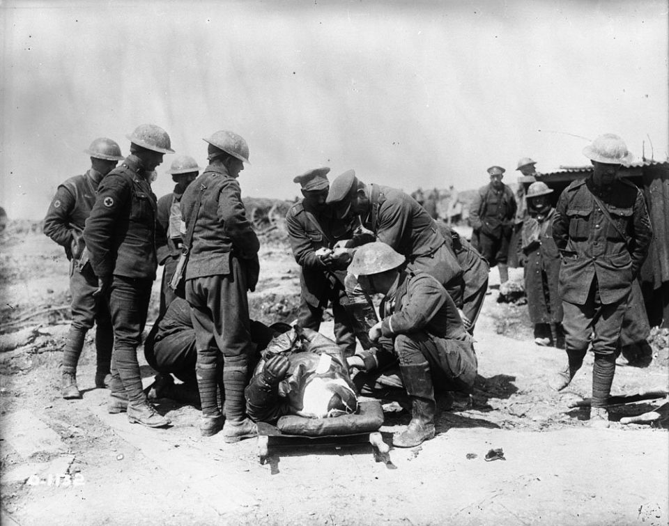 Treating a downed airman at Vimy (LAC M#3521885).