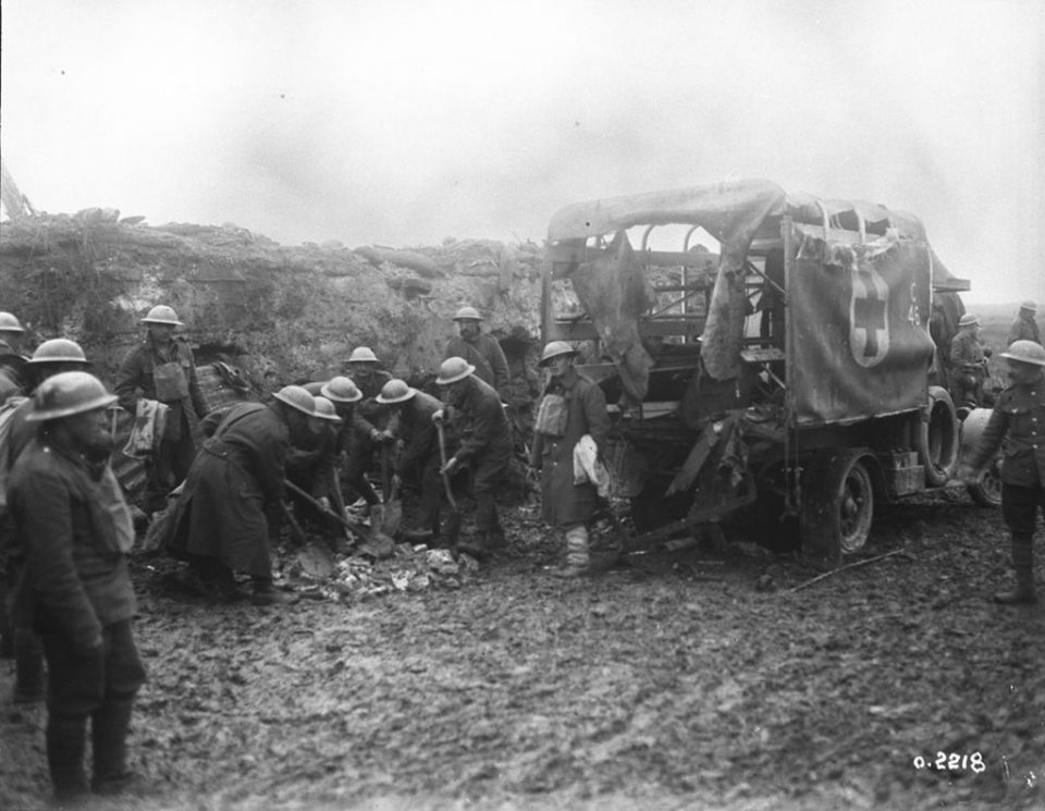 Pioneer battalion members fill a shell hole. The ambulance had 2 casualties inside when the shell struck (LAC M#3522042).