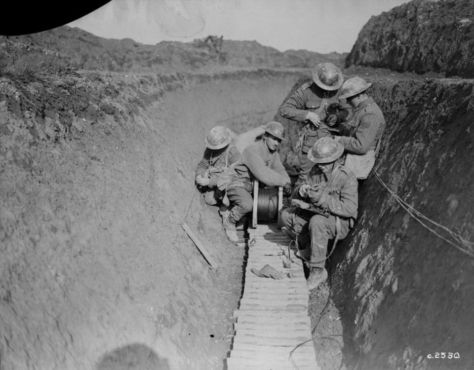 Communications repairs by Canadian Signallers, February 1918 (LAC M#3405811).