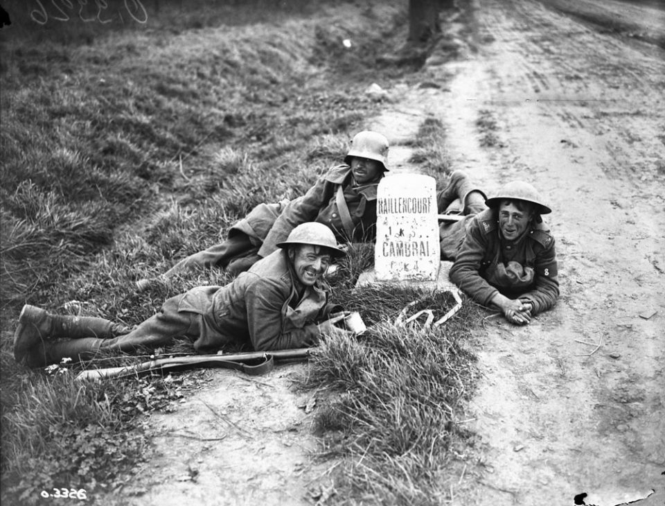 Two Canadians with a prisoner just outside Cambrai (LAC M#3522299).