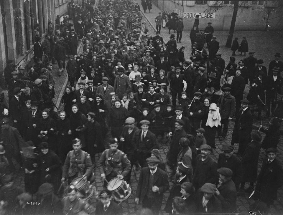Marching through Mons on Nov. 11, 1918 (LAC M#3522379).