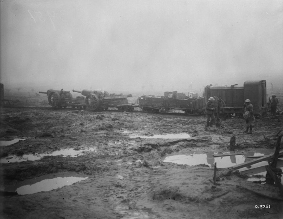 Two naval artillery guns being moved on the Passhcendaele battleground via Canadian light rail (LAC M#3395320).